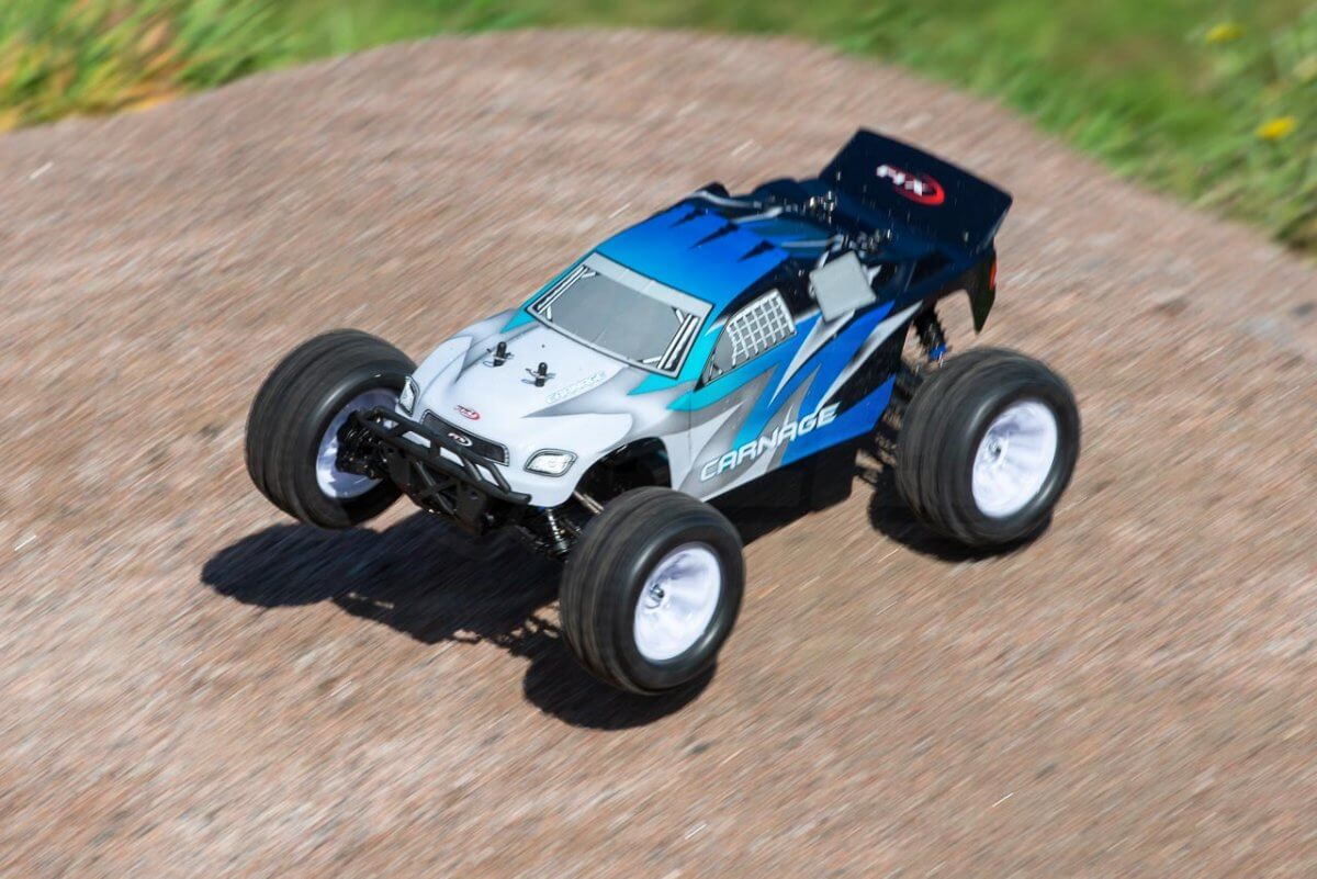 FTX Carnage Brushed versus Brushless comparison review brushed small jump