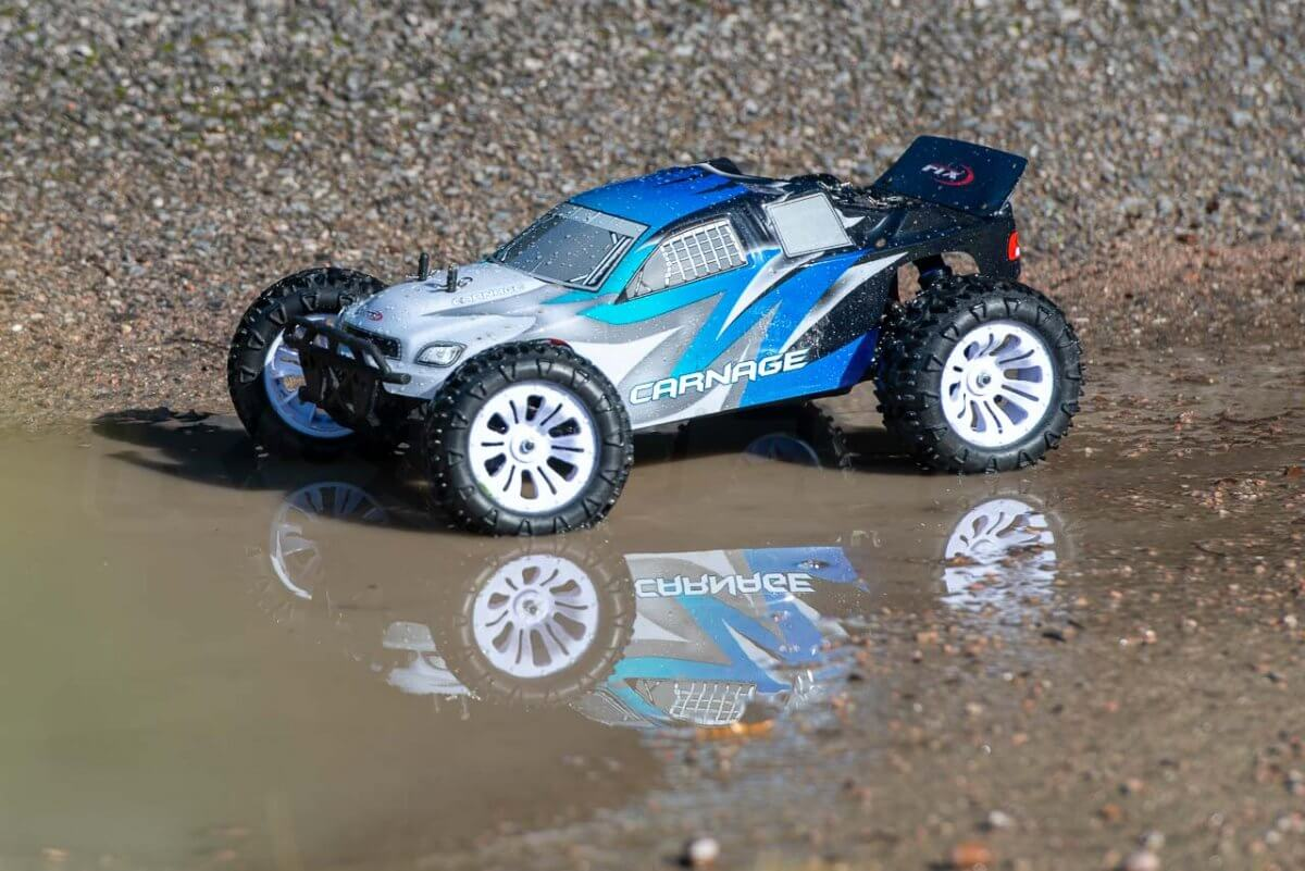FTX Carnage Brushed versus Brushless comparison review brushed water reflection