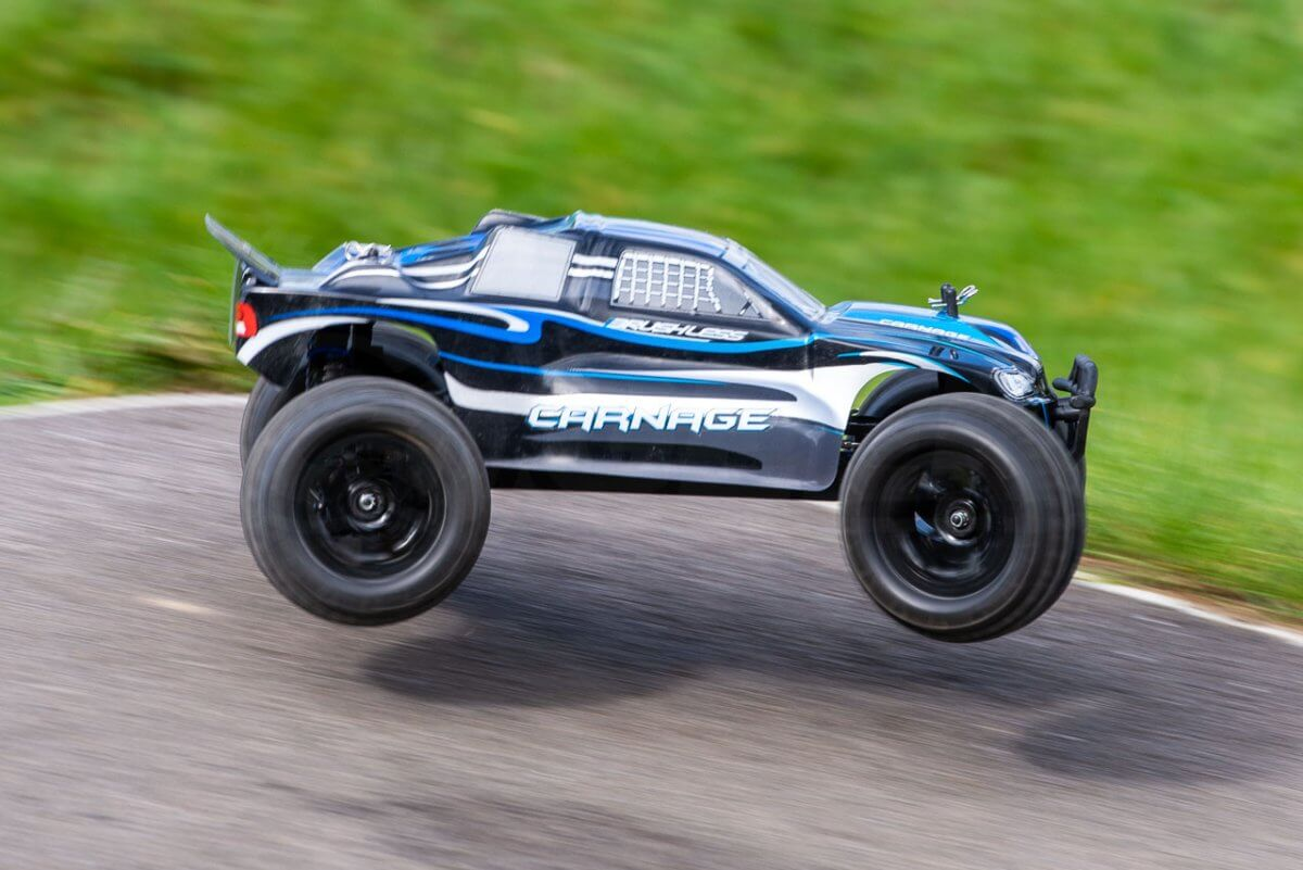 FTX Carnage Brushed versus Brushless comparison review brushless on tarmac fast jumps