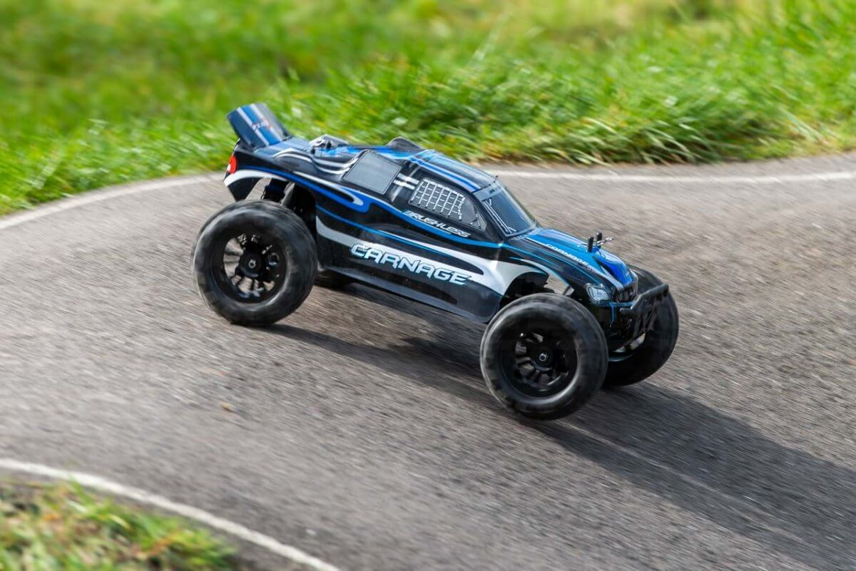 FTX Carnage Brushed versus Brushless comparison review brushless on tarmac fast landing