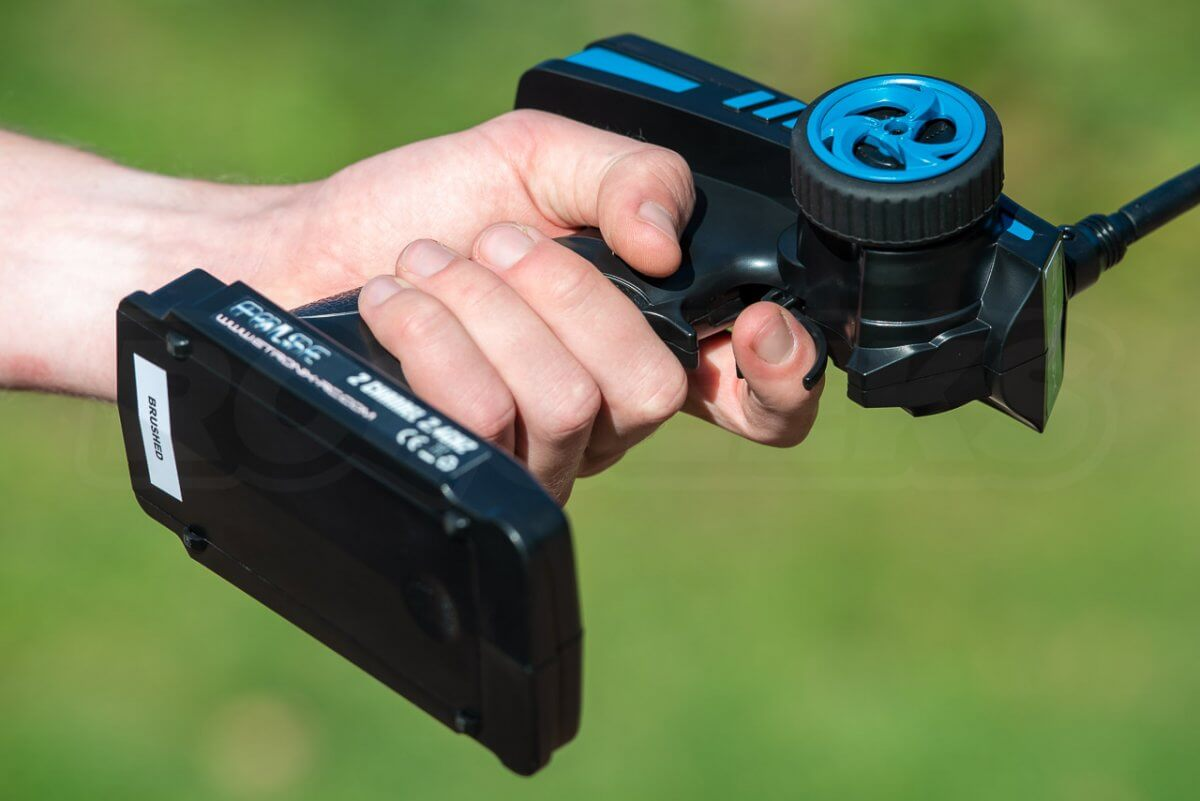 FTX Carnage Brushed versus Brushless comparison review transmitter etronix in the hand