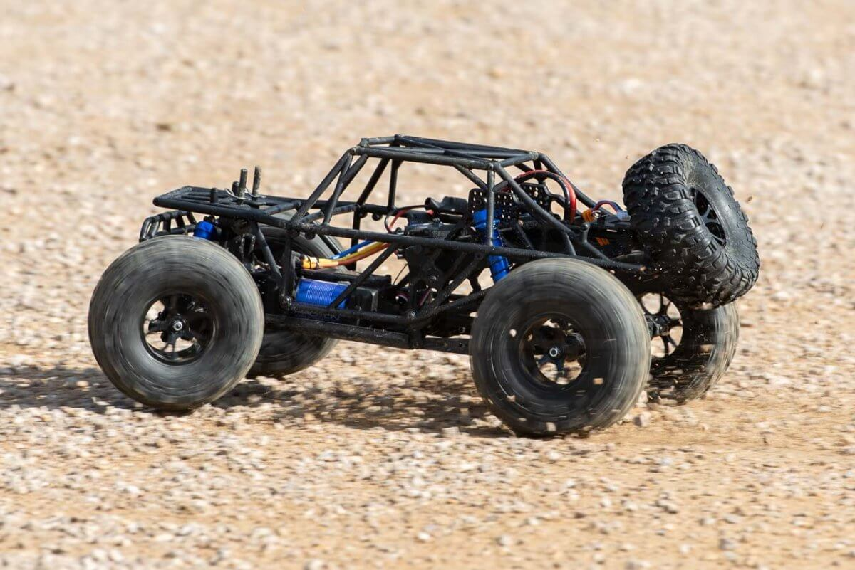 FTX Outlaw Ultra-4 Brushless Buggy Review naked on gravel four