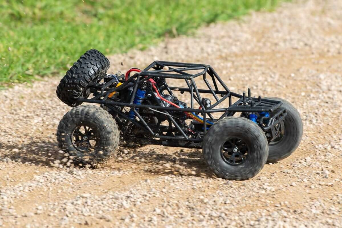 FTX Outlaw Ultra-4 Brushless Buggy Review naked on gravel three