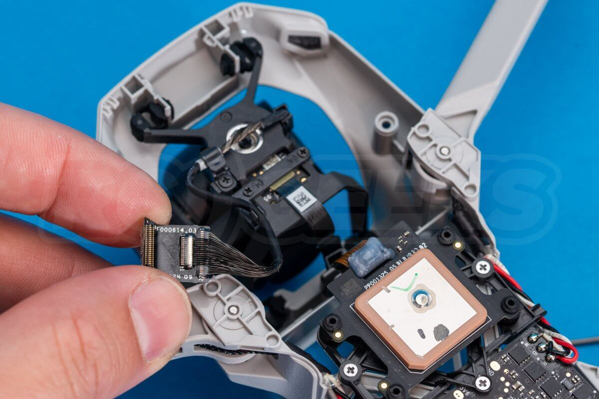 DJI Mavic Mini drone teardown guide repair gimbal cable released from mainboard