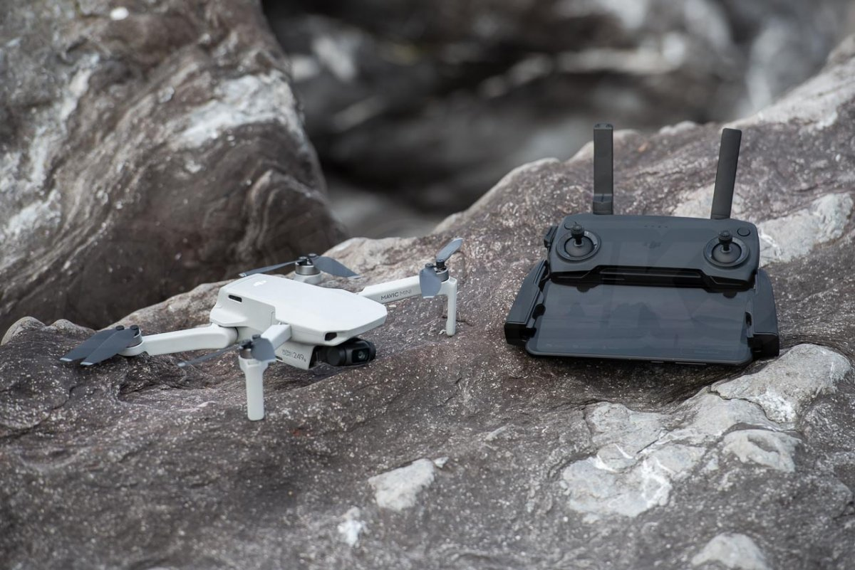 DJI Mavic Mini Review drone on a rock with transmitter