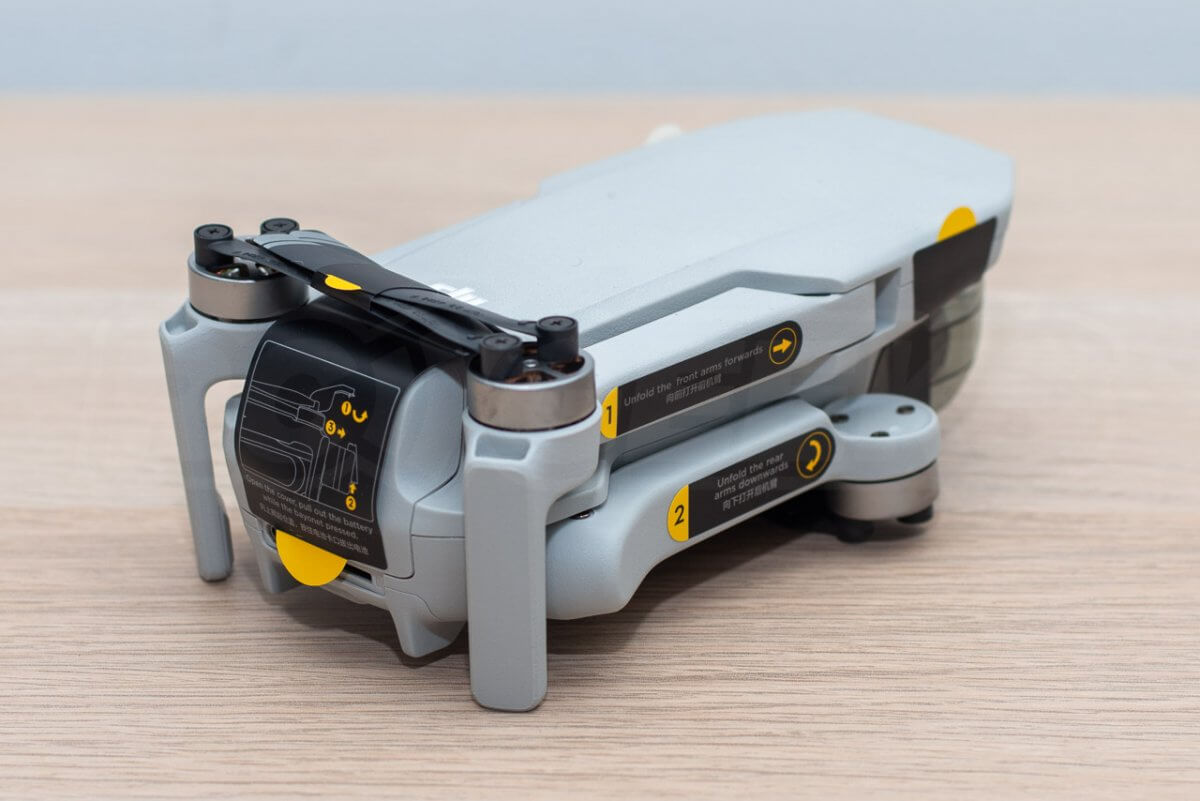 Mavic Mini Review unboxing drone stickered up rear edge
