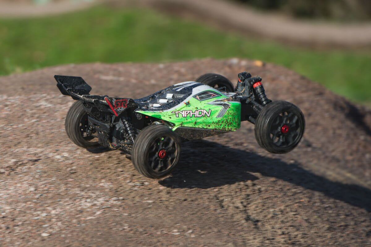 Arrma Typhon MEGA 4x4 Buggy skipping across jumps