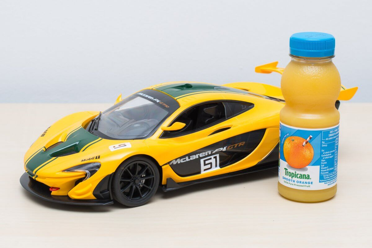 1/14th scale compared to a small bottle of orange juice, car measures 30cm long